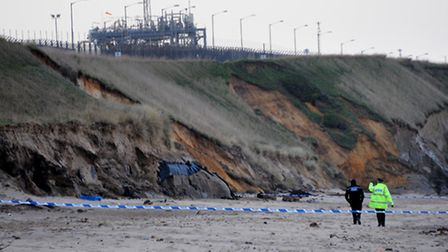 Police cordon off the beach at Bacton after the piece of scrap metal was discovered. PHOTO: ANTONY K