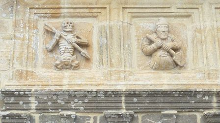 L'Ankou (left) carved on the ossuary of Ploudiry in Brittany, Pic: Moreau.henri