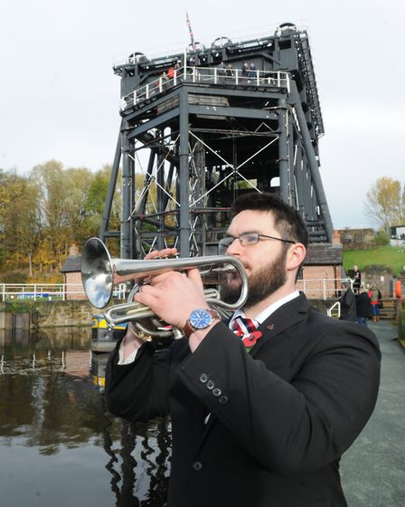 A bugler at the Anderton Boat Lift plays at the Poppy Cavalcade to commemorate the 'forgotten' water