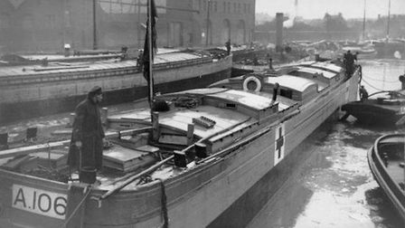 A precious cargo of British wounded, probably in Calais Dock, brought in a converted French barge. T