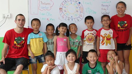 Ollie Cole with pupils at his English language school in Hexian, China