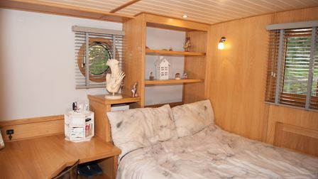 The middle-sized bedroom is at the stern