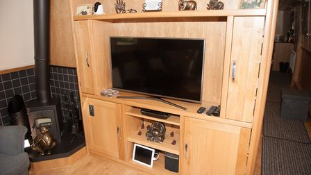 The large flat screen TV is connected to a self-seeking satellite dish