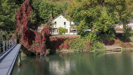 In an idyllic location by the river, this four-bedroom house is sold fully furnished
