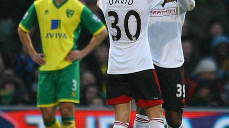 Norwich City defender Steven Whittaker casts a dejected figure afer Fulham's Darren Bent opened the
