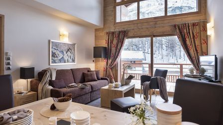 The open-plan living area is ideal to unwind in after long day on the slopes.