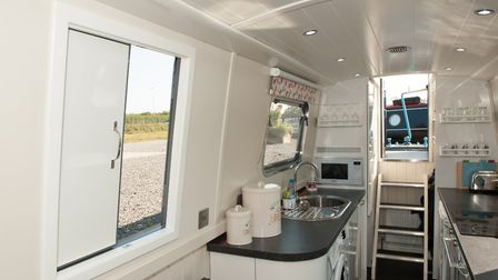 The light and airy galley continues the white theme (photo: Andy R Annable)