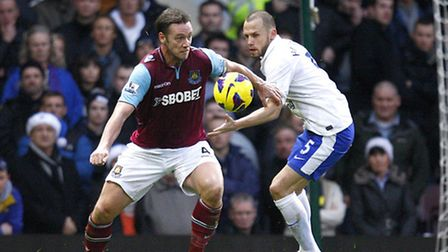 Everton's Johnny Heitinga (right) and West Ham United's Kevin Nolan (left) battle for the ball durin