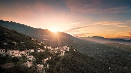 Catch the sunset at Belgodere for a magical Corsican experience. Pic: joningall/iStock/Getty