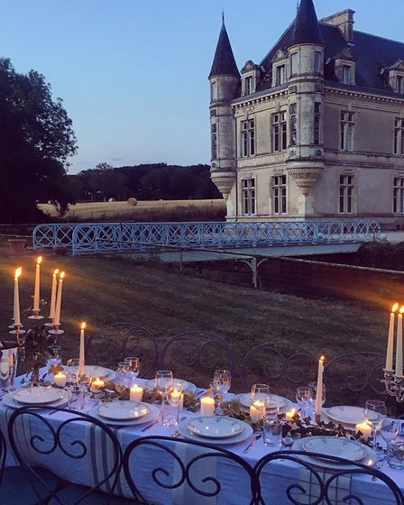 Dining alfresco by candlelight at Chateau de Bourneau