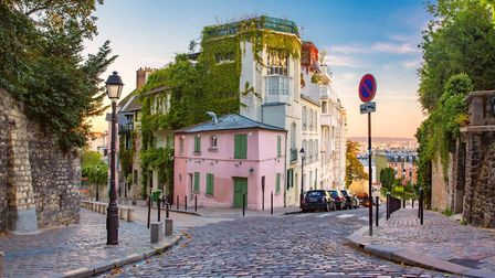The picture-perfect pink Maison Rose in Montmartre. Pic: KavalenkavaVolha/iStock/Getty