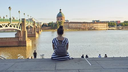 woman sitting in the river in Toulouse