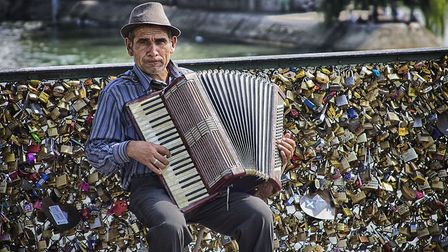 An accordion player on Pont des Arts. Pic: Ben Francis/Flickr/CC BY 2.0