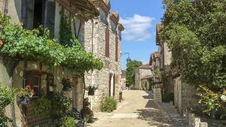 Picturesque architecture in early summer sunshine in Pujols, Lot-et-Garonne, France. This historic v