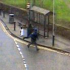 Police have released CCTV stills after a robbery outside a bank in Soham.