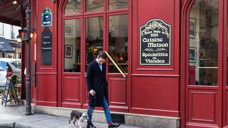 Frank takes dog Parker for a walk through the streets of Paris © Joann Pai