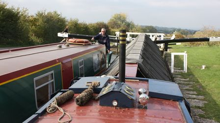 """""""Part of an egalitarian community"""" - a hireboat and an ex-working boat pass each other on the K&A (p"""