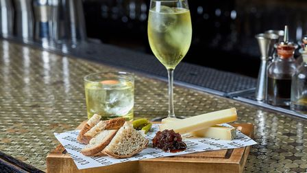 Enjoy a cocktail with an aged French Comté cheese and chutney board at Coupette (c) John Athimaritis