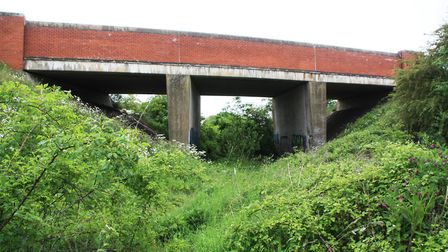This former freight railway bridge will carry the A610 over the diverted canal (photo: Martin Ludgat