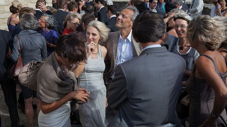 Outside the Saint-Romain church in Crillon-le-Brave, a wedding guest enjoys being blasted by the mis