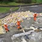 The Toddbrook dam spillway, with ballast placed on the damaged area to reduce chances of collapse (p