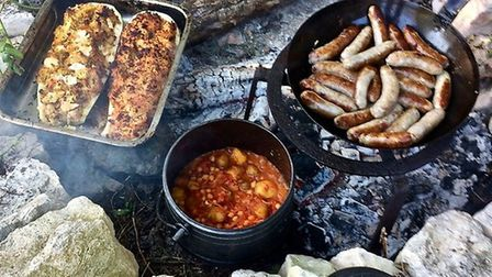 The family often enjoys supper cooked on an open fire