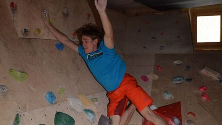 James Pearson on his climbing wall at home