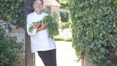 Raymond Blanc with vegetables grown in his organic garden