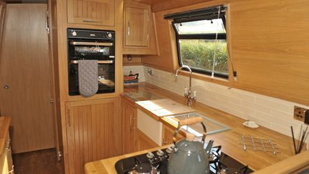 The Belfast sink is fitted with a wooden top so no space is lost (photo: Andy R Annable)