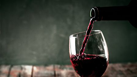 Pouring a glass of red wine (c) mythja/Getty Images