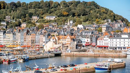 Learn about the beautiful towns of Calvados, including pretty Honfleur (c) RossHelen/Getty Images