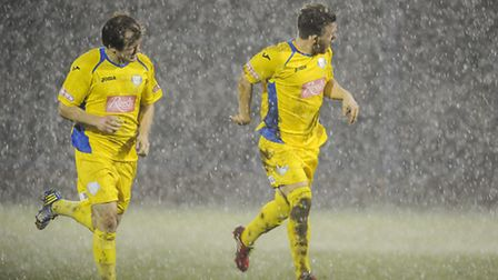 Action from King's Lynn Town v Ilkeston at The Walks - Hail and rain holds up the second half. Pictu
