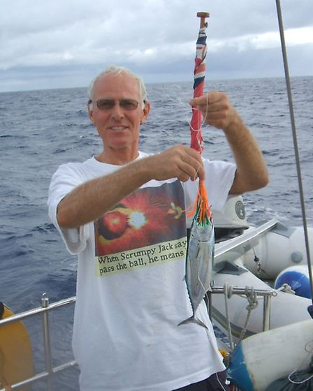 Roger Pratt, aboard Magetic Attraction, proudly showing the Tuna he had caught during the Atlantic c