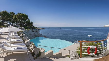 The infinity swimming pool is refreshed with natural seawater