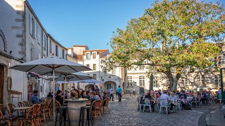 Eating outside on the terrace in summer in the old town of La Rochelle (c) Delpixart/Getty Images