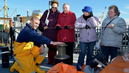 Lifeboat crew member James Tacon showing a group of ladies some of the equipment on the deck of Lowe
