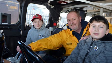 Dylan and Evan Jones with lifeboatman Andy Smithpic by mick howes