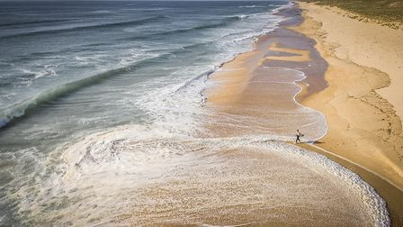 A surfer on the beach at Moliets-et-Maa (c) photography-wildlife-de/Getty Images
