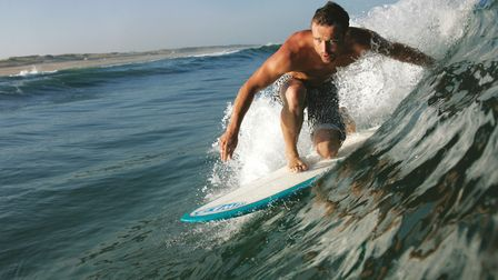 Surfer on Hossegor waves (c) Buzz Pictures / Alamy Stock Photo