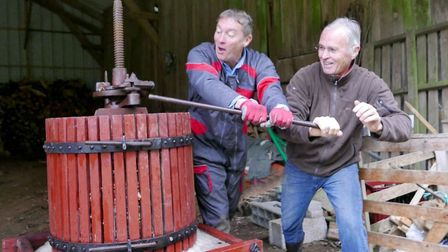 Rene (left) and friend pressing the apples. Pic: Michael Cranmer