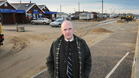 North Norfolk District Council leader Tom FitzPatrick amid the storm damage clean up at Walcott. PHO