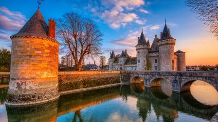 Sully-sur-Loire at sunset is our FRANCE Calendar 2021 image for January. Pic: Javier Castro/Getty