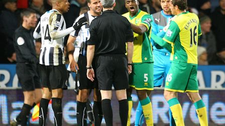 Loic Remy of Newcastle appears to head butt Bradley Johnson of Norwich which sparks confrontation be