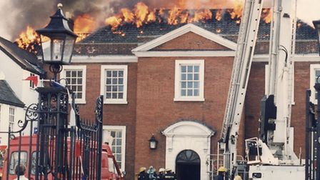 Flames leap from the roof of the Assembly House during the fire in 1995.