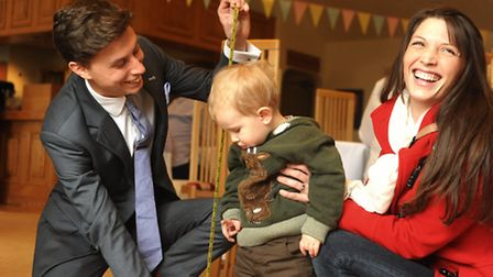 Elliot Suiter measures young Alexander (21 months) up for his suit watched by his mum Alison Grant.