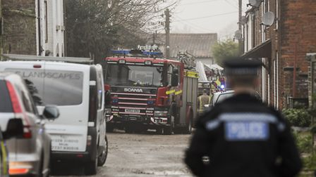 The fire service and police attend a house fire on Church Lanes in Fakenham. Picture: Matthew Usher.