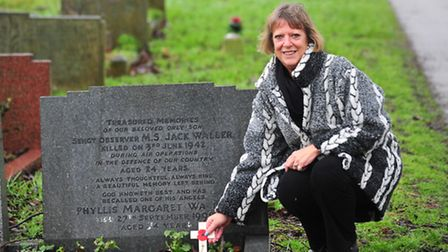 Paula Masters at the grave of Jack Waller who was in the RAF and was shot down over lowestoft in 194