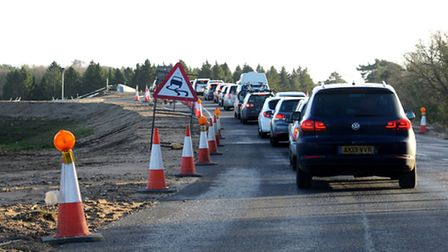 Traffic queueing over a section of the new A11 that runs near Elveden taken from one of the new brid