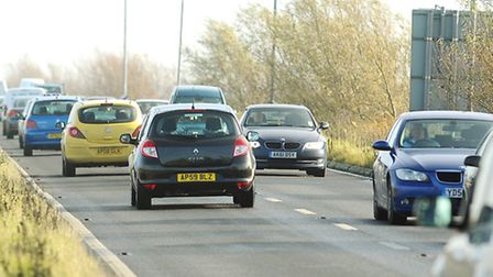 Traffic on the A47 Acle Straight which runs between Great Yarmouth and Acle passing through Halverg