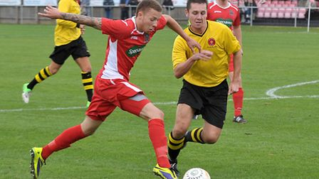 Tom James, left, was Wisbech's two-goal hero on Saturday. Picture: Steve Williams